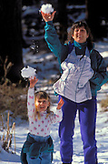 Mother with infant and child (age 3) throwing snowballs, Los Padres National Forest, California