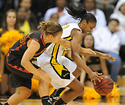 Dec 3, 2009; Long Beach, CA, USA; Long Beach State 49ers forward Ashley Bookman (12) is defended by Southern California Trojans guard Daniela Roark (25) at the Walter Pyramid. USC defeated Long Beach State 83-77.