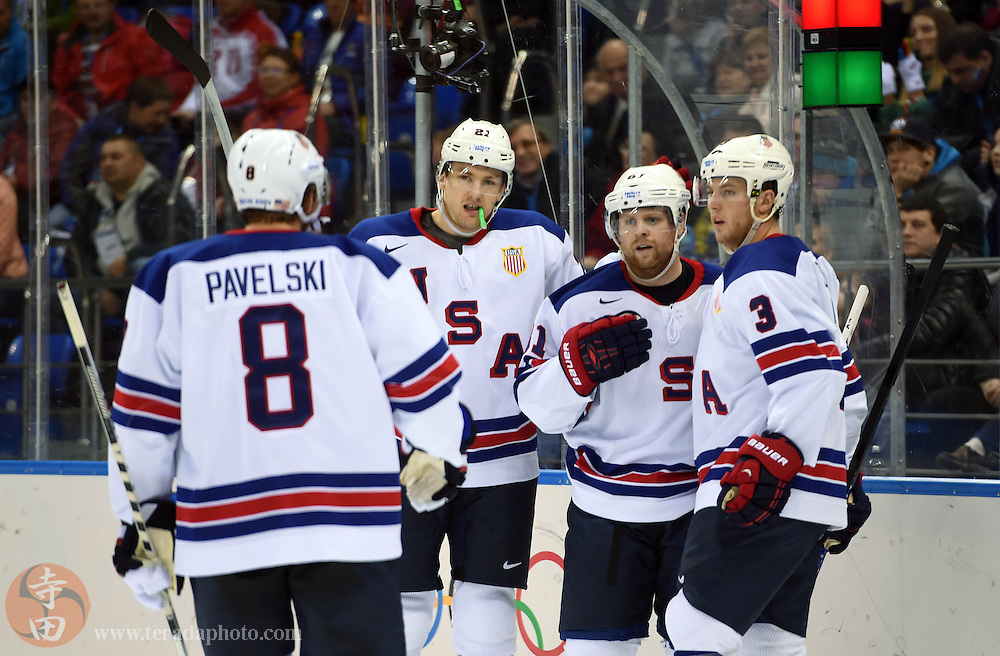 Feb 16, 2014; Sochi, RUSSIA; USA forward Phil Kessel (81) is congratulated by teammates Cam Fowler (3) , Joe Pavelski (8) and James van Riemsdyk (21) after scoring a hat trick goal against Slovenia in the second period of a men's ice hockey preliminary round game during the Sochi 2014 Olympic Winter Games at Shayba Arena.