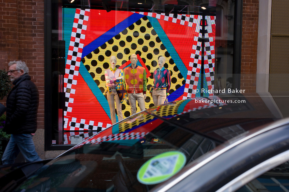 A theme of circles and a window theme of dots in the window of Etro on Old Bond Street, central London.