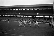 21/10/1962<br /> 10/21/1962<br /> 21 October 1962<br /> Oireachtas Final: Tipperary v Waterford at Croke Park, Dublin.<br /> Waterford goalie, N. Power, is aided by a defender in this clearance as Tipperary's L. Devaney looks on powerless to intervene.