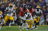 Ole Miss' wide receiver Laquon Treadwell (1) catches a pass and is tackled by LSU's defensive end Danielle Hunter (94) at Tiger Stadium in Baton Rouge, La. on Saturday, October 25, 2014. LSU won 10-7.