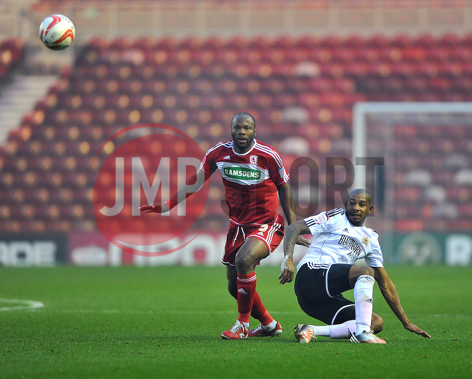 Bristol City's Marvin Elliott battles for the high ball with Middlesbrough's Andre Bikey - Photo mandatory by-line: Joe Meredith/JMP  - Tel: Mobile:07966 386802 24/11/2012 - Middlesbrough v Bristol City - SPORT - FOOTBALL - Championship -  Middlesbrough  - River Side Stadium
