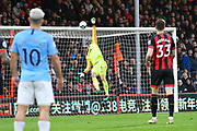 Sergio Aguero (10) of Manchester City watches as his shot at goal beats Artur Boruc (1) of AFC Bournemouth but hits the bar during the Premier League match between Bournemouth and Manchester City at the Vitality Stadium, Bournemouth, England on 2 March 2019.