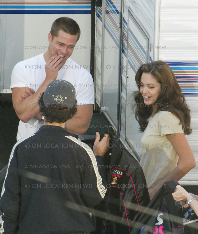January 22, 2004 Los Angeles, California ***EXCLUSIVE*** The very first images of Brad Pitt and Angelina Jolie together. Pitt and Jolie arrive to the set to begin filming Mr. & Mrs. Smith. After Pitt kiises Jolie on the cheek the two discuss the script and wardrobe with the director. Photo by Eric Ford 818-613-3955 info@onlocationnews.com