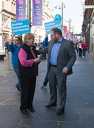 Veteran campaigner Annabel Goldie MSP  joined activists operating a street stall on Buchannan Street in Glasgow. There was some difficulty in encouraging anybody to hear what Ms Goldie had to say apart from Greg McDermid who was persuaded to stop and tell Mis Goldie he wasn't a Tory!<br /> Glasgow 8 April 2015  Ger Harley, StockPix.eu