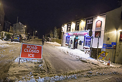 © Licensed to London News Pictures . 24/03/2013 . Burnley , UK . Todmorden Road is closed to traffic due to snow and ice . Snowdrifts are making roads impassable around Burnley overnight (23rd/24th March) as high winds blow snow across roads . Plummeting temperatures and treacherous conditions are reported to have taken the life of a man named locally as Gary Windle . Lancashire Police reported finding a 27 year old man dead in deep snow yesterday (23rd March) afternoon . Photo credit : Joel Goodman/LNP