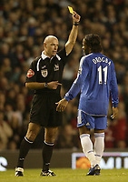 Photo: Aidan Ellis.<br /> Manchester United v Chelsea. The Barclays Premiership. 26/11/2006.<br /> Chelsea's Didier Drogba recieves a yellow card from referee Howard Webb