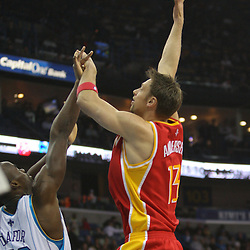 Jan 02, 2010; New Orleans, LA, USA; Houston Rockets center David Andersen (13) shoots over New Orleans Hornets center Emeka Okafor (50)during the second quarter at the New Orleans Arena. Mandatory Credit: Derick E. Hingle-US PRESSWIRE