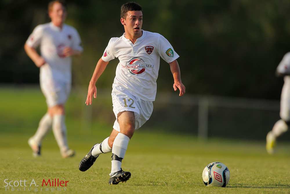Orlando City defender David Graydon (12) during Orlando City's 2-1 win over Laredo Heat in their PDL Southern Conference Championships playoff game at Trinity Catholic High Schooll on July 20, 2012 in Ocala, Florida. ..©2012 Scott A. Miller