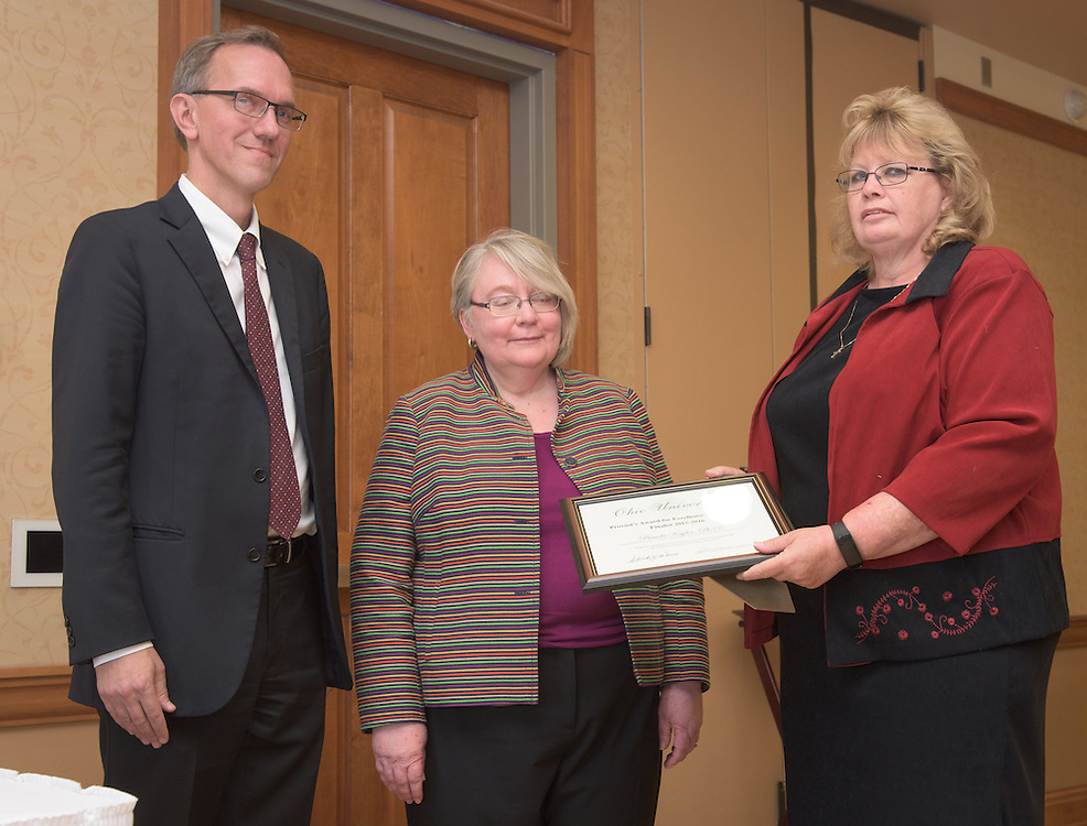 From left: Joseph Shields, Vice President for Research & Creative Activity and Dean of Ohio University's Graduate College along with Pam Benoit, Executive Vice President and Provost, congratulate Pamela Kaylor for being a finalist for the Provost's Award for Excellence in Teaching during the 2016 Faculty Awards Recognition Ceremony held at Baker Center on Tuesday, September 6, 2016.