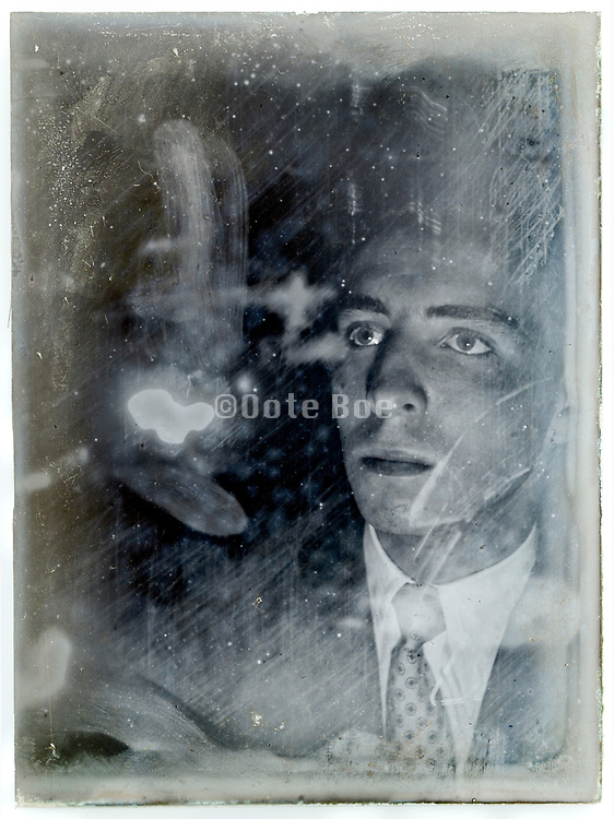 vintage spooky lighting portrait of a young adult man