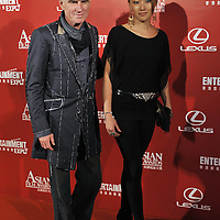 HONG KONG - MARCH 23:  Australian cinematographer Christopher Doyle and Rain Li arrive to the Asian Film Awards 2009 at the Hong Kong Convention and Exhibition Centre on March 23, 2009 in Hong Kong.  Photo by Victor Fraile / studioEAST