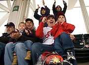 John Frient, Tom Frient and Tyler Babik, 2, all of Akron, as well as Chris Gambaccini and his son Tyler, 5, of Sevil all cheer on the Indians during the second inning of Monday's home opener against the Chicago White Sox at Progressive Field.