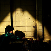 May 09, 2013 - Yangon, Myanmar: A woman lights candles at a shrine in Sule Pagoda, in central Yangon. CREDIT: Paulo Nunes dos Santos