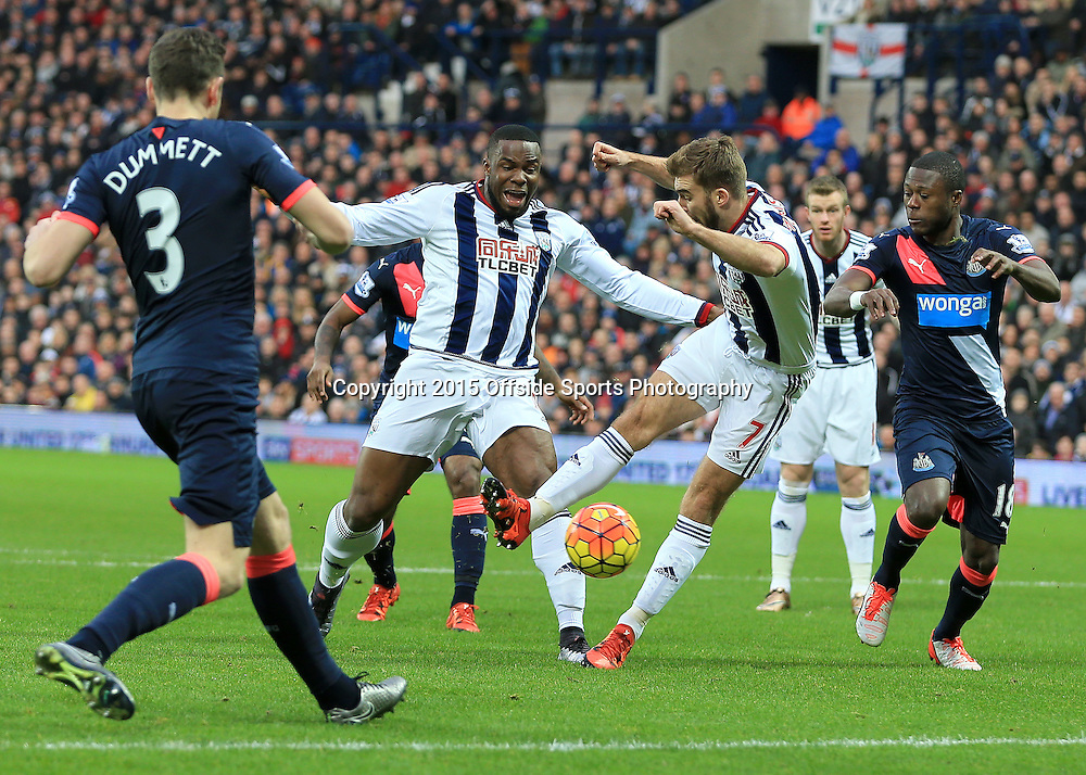 28th December 2015 - Barclays Premier League - West Bromwich Albion v Newcastle United - James Morrison takes a shot off the toe of Victor Anicheebe of West Bromwich Albion - Photo: Paul Roberts / Offside.