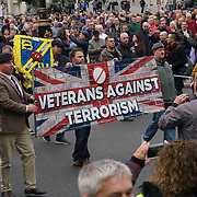 "London, England, UK. 7th October 2017. Thousands ""Football Lads Alliance"" march in London AND Stand up against Racism protest against the ""Football Lads Alliance"" March to Stand together: no to racism & Islamophobia and un-aspected Gurkha's veterans join the fascist ""Football Lads Alliance"" at the roundabout in front of Trafalgar Square."