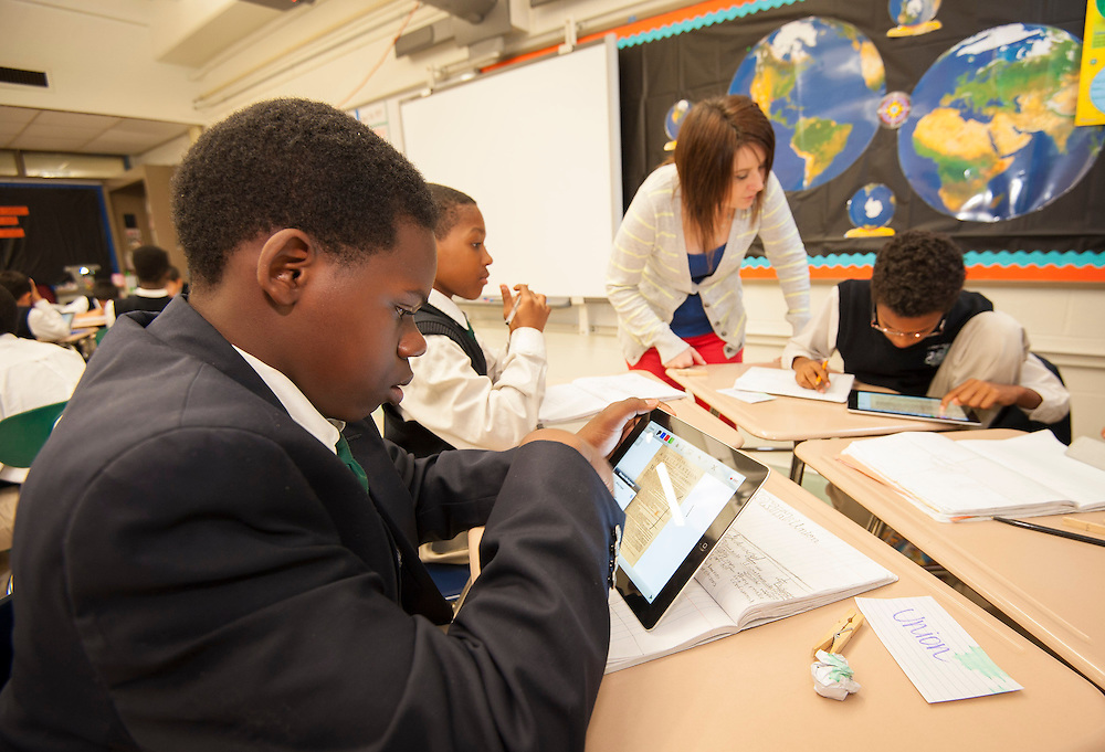 Sixth graders make use of iPads in their history class at Young Men's College Preparatory Academy April 26, 2013.