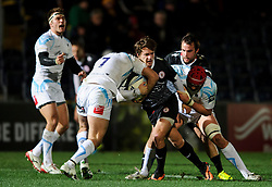 Biarritz Outside Centre (#13) Geoffrey Sella is tackled by Worcester Flanker (#7) Sam Betty and Number 8 (#8) Jonathan Thomas (capt) during the first half of the match - Photo mandatory by-line: Rogan Thomson/JMP - Tel: Mobile: 07966 386802 - 05/12/2013 - SPORT - RUGBY UNION - Sixways Stadium - Worcester Warriors v Biarritz Olympique Pays Basque - Amlin Challenge Cup Pool 1.
