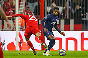 Tottenham Hotspur midfielder Ryan Sessegnon (19) beats Bayern Munich forward Thomas Müller (25) to the ball during the Champions League match between Bayern Munich and Tottenham Hotspur at Allianz Arena, Munich, Germany on 11 December 2019.