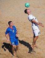 CATANIA, ITALY - AUGUST 16: Valeriu Costin of Moldova competes for the ball with Sander Lepik of Estonia during the Euro Beach Soccer League match between Moldova and Estonia on August 16, 2019 in Catania, Italy. (Photo by Quality Sport Images/