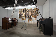 """Sandra Anible's installation, entitled """"The Repeat."""" Player pianos, music scrolls and mixed media."""