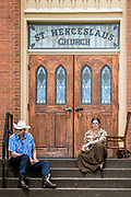 Leander Vyhlidal, of Norfolk, Neb., and Adrianne Adderley, of Yankton, sit on the stoop in front of St. Wenceslaus Church watching the parade go by during the 69th Annual Czech Days parade on Friday, June 16, 2016 in Tabor. (Matt Gade / Republic)