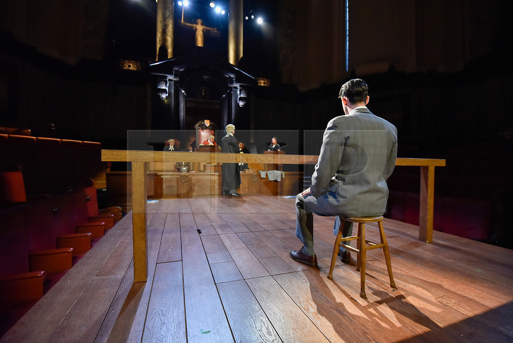 """© Licensed to London News Pictures. 20/10/2017. London, UK. Jack McMullen as Leonard Vole, the accused, sits in the dock. Photocall for """"Witness for the Prosecution"""", by Agatha Christie, directed by Lucy Bailey, at London County Hall.  The play opens 23 October. Photo credit : Stephen Chung/LNP"""