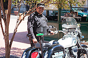 Policeman with his motorcycle