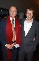 Left to right, SIMON PARKER BOWLES and his nephew TOM PARKER BOWLES son of Camilla Parker Bowles at a party to celebrate the publication of 'E is for Eating' by Tom Parker Bowles held at Kensington Place, 201 Kensington Church Street, London W8 on 3rd November 2004.<br />