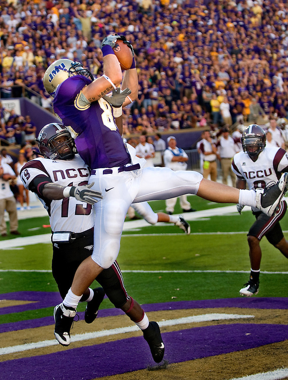 09/06/08-(Harrisonburg).JMU tight end Mike Caussin pulls in a pass for a touchdown over North Carolina Central University's Kurtis Campbell during second quarter action at Bridgeforth Stadium Saturday..(Pete Marovich/Daily News-Record)