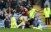 Burnley midfielder George Boyd (21) and Brighton defender, full back, Liam Rosenior (23) during the Sky Bet Championship match between Burnley and Brighton and Hove Albion at Turf Moor, Burnley, England on 22 November 2015.