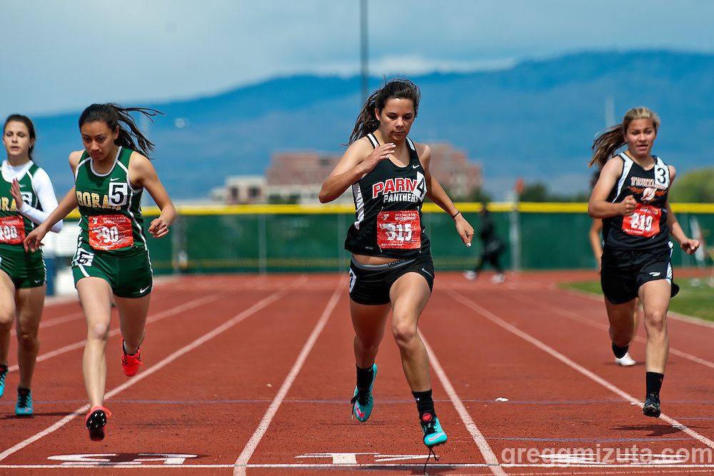 Girls (L to R: Borah junior Mattea Chipman, Parma senior Rebekah Compas, and Fruitland sophomore Sophie Cowgill) open 200 meter finals during the YMCA Track & Field Invitational at Mountain View High School, Meridian, Idaho. April 25, 2015. Compas won (28.68) followed by Chipman (28.91) and Cowgill (29.49).