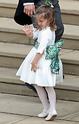 Princess Charlotte waves as she arrives at the wedding of Princess Eugenie and Jack Brooksbank at St George's Chapel in Windsor Castle.
