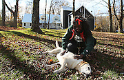 Student Chelsea Agyakwa, once fearful of animals, pets Ketzel on the grounds of the Mountain School
