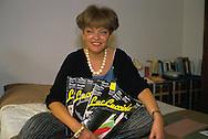 Roberta Tatafiore (Foggia, 1943 - Roma, 8 aprile 2009) è stata un'attivista femminista e libertaria italiana, scrittrice, poetessa e studiosa del fenomeno della prostituzione e della sessualità femminile. Ritratta nella sua casa di Roma con  Lucciola, il mensile da lei fondato dedicato ai diritti civili delle prostitute.