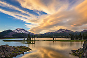 Sunset clouds over Broken Top and South Sister from Ray Atkeson Memorial viewpoint at Sparks Lake; Cascade Mountains, Central Oregon.