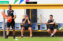 Hull City manager Steve Bruce shields his mouth whilst speaking on the phone before the game - Mandatory by-line: Matt McNulty/JMP - 19/07/2016 - FOOTBALL - One Call Stadium - Mansfield, England - Mansfield Town v Hull City - Pre-season friendly