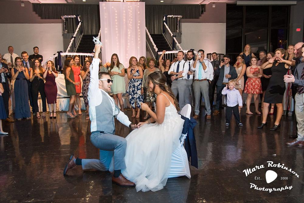 wedding garter toss by Tallmadge wedding photographer, Akron wedding photographer Mara Robinson Photography
