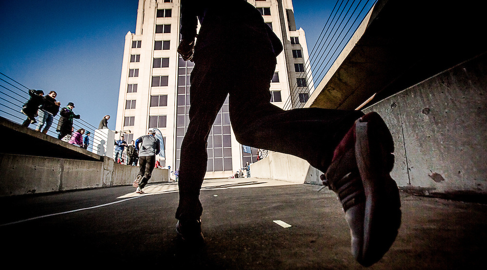 SAM DEAN   FOR THE ROANOKE TIMES.020913--Competitors i Saturday's WAZUPWIDIS urban, a 2.75 mile race that featured 660+ steps of climbing up the Wells Fargo Tower and other downtown structures.Roanoke County
