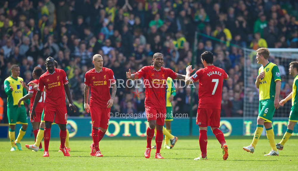 NORWICH, ENGLAND - Sunday, April 20, 2014: Liverpool's Glen Johnson celebrates his side's 3-2 victory over Norwich City with team-mate Luis Suarez during the Premiership match at Carrow Road. (Pic by David Rawcliffe/Propaganda)