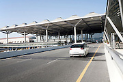 White taxi car arriving at Malaga airport, Spain