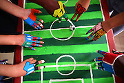 LIAOCHENG, CHINA - MAY 22: (CHINA OUT) <br /> <br /> Students use their painted fingers kick soccer during a competition at Liaocheng University on May 22, 2016 in Liaocheng, Shandong Province of China. Eight Chinese students and two foreign students majored in sport painted their fingers as soccer players and play the soccer game with fingers at Liaocheng University. <br /> ©Exclusivepix Media