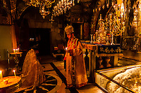 An Armenian orthodox mass at the  in the Altar of the Crucifixion in the Church of the Holy Sepulchre (site of the last five stations of the Cross and venerated as the place where Jesus was crucified and buried), the Christian Quarter, Old City, Jerusalem, Israel.