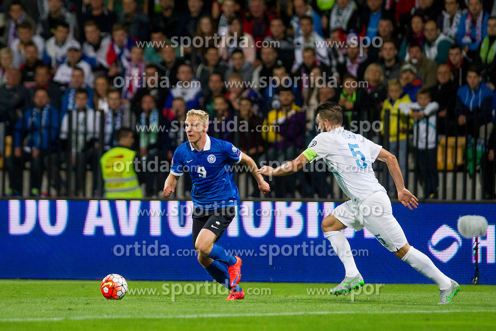 Ats Purje of Estonia and Bostjan Cesar of Slovenia during the EURO 2016 Qualifier Group E match between Slovenia and Estonia at Ljudski vrt on September 8, 2015 in Maribor, Slovenia. Photo by Urban Urbanc / Sportida