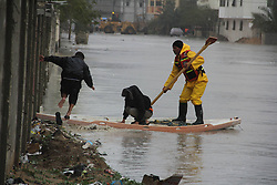 A rescue worker helps two boys cross a flooded street in the southern Gaza Strip city of Rafah, Jan. 9, 2013. Rescuers have been sent to evacuate dozens of from their flooded houses since heavy rain and snow hit the region on Monday, January 9, 2013. Photo by Imago / i-Images...UK ONLY
