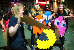© Licensed to London News Pictures . 26/12/2017. Wigan, UK. Pac Man . Revellers in Wigan enjoy Boxing Day drinks and clubbing in Wigan Wallgate . In recent years a tradition has been established in which people go out wearing fancy-dress costumes on Boxing Day night . Photo credit: Joel Goodman/LNP