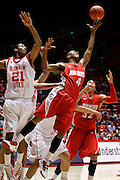 New Mexico forward Chad Adams (4) goes after a rebound as Utah guard Will Clyburn (21) and New Mexico forward Drew Gordon (32) watch the ball during the second half of an NCAA college basketball game, Wednesday, Jan. 19, 2011, in Salt Lake City, Utah. Utah defeated New Mexico 82-72. (AP Photo/Colin E Braley)