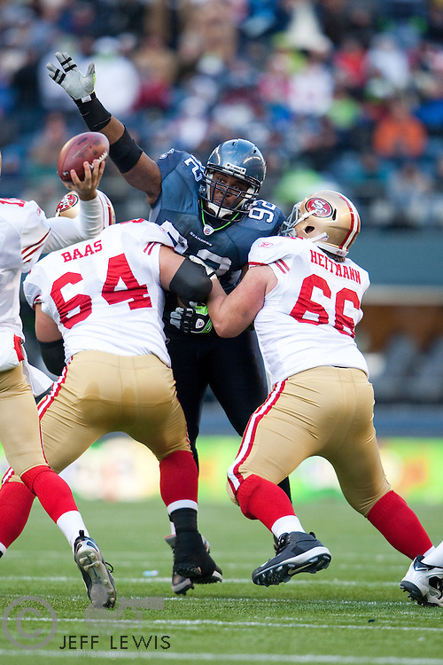 06 December 2009: Defensive Tackle (92) Brandon Mebane of the Seattle Seahawks reaches up to block the pass of Alex Smith of the San Francisco 49ers during the first half of the Seahawks 20-17 victory over the 49ers at Quest Field in Seattle, Washington.