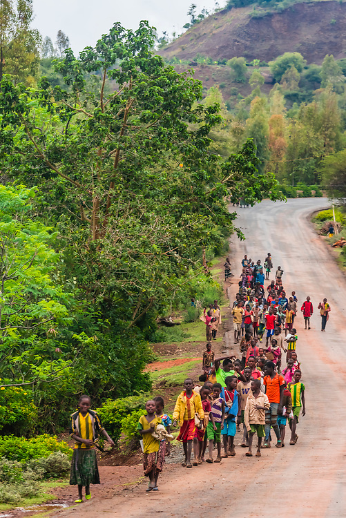 Konso tribe schoo children walking home from school, Omo Valley, Southern Nations Nationalities and People's Region, Ethiopia.